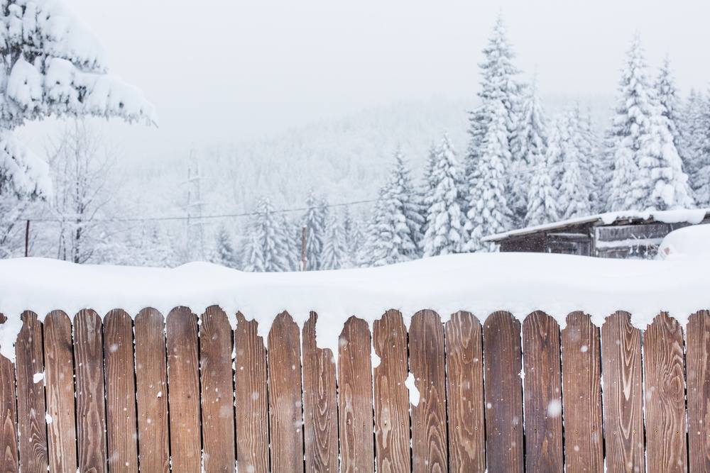 a wooden fence in winter