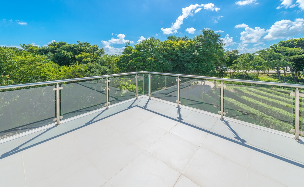 Tempered glass railings give you full visibility of your property.