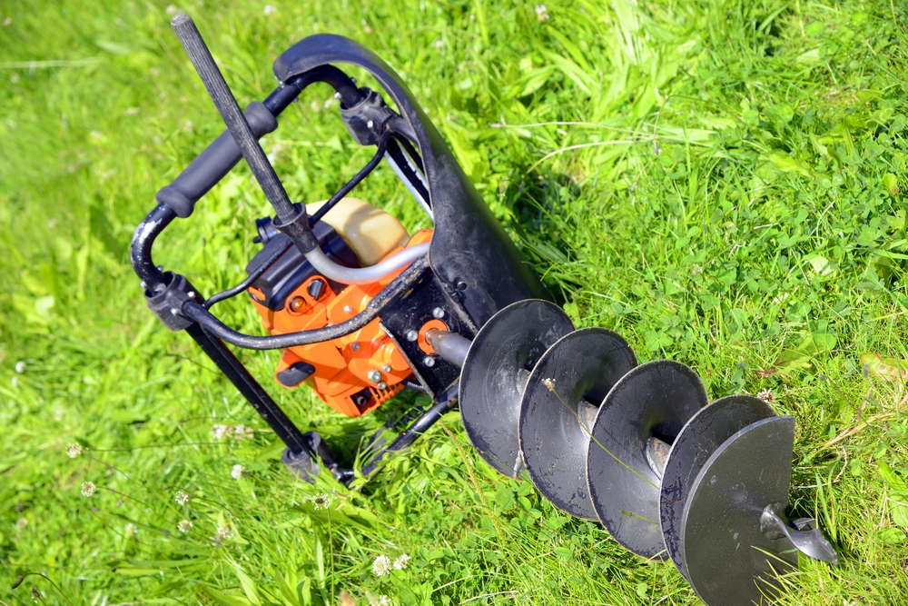 An auger or post hole digger.