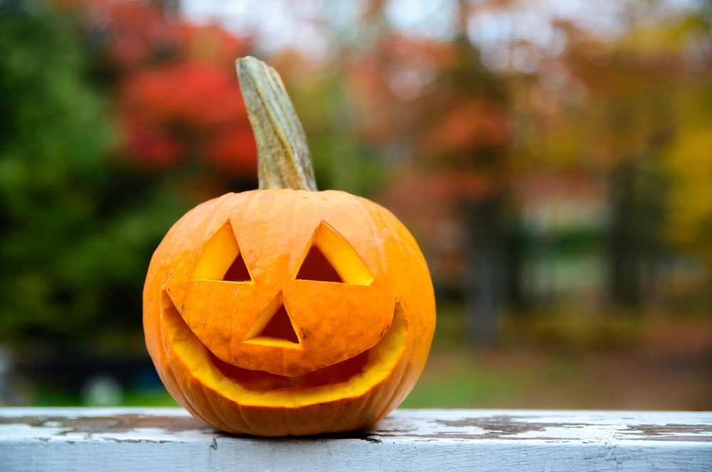 Jack-o-lanterns are a great fixture for your deck, but to avoid rot, don't place them directly on the surface.