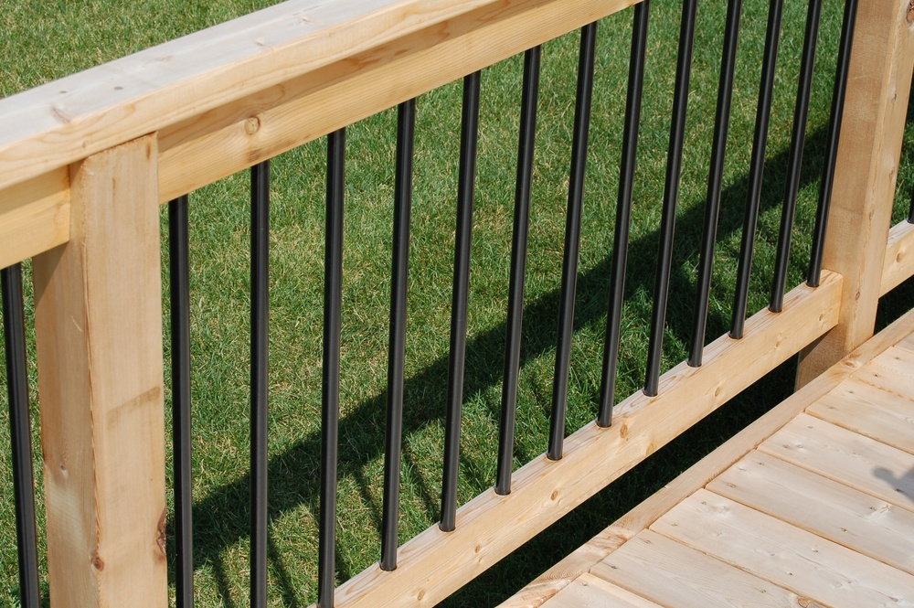 Deck railings can be made out of more than one material, like this aluminum and wood railing.